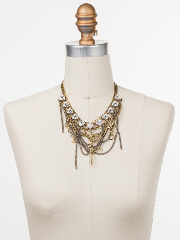 Smythe Statement Bib Necklace in Mixed Metal Crystal displayed on a necklace bust