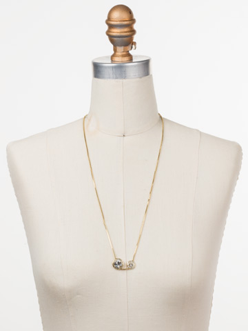 Dua Adjustable Choker Necklace in Bright Gold-tone Crystal displayed on a necklace bust