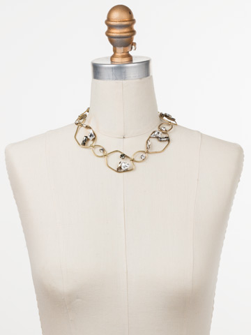 Presley Collar Necklace in Antique Gold-tone Crystal displayed on a necklace bust
