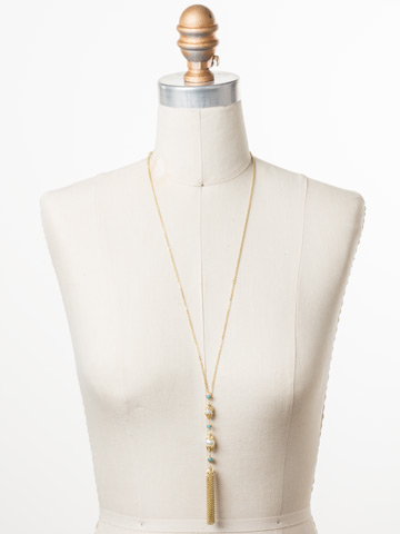 Concetta Long Strand Necklace in Bright Gold-tone Polished Pearl displayed on a necklace bust