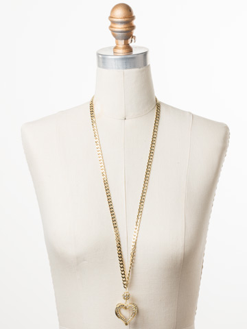 Adelynn Long Strand Necklace in Bright Gold-tone Polished Pearl displayed on a necklace bust