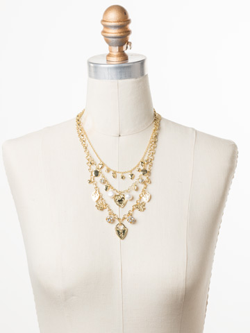 Clarette Necklace in Bright Gold-tone Polished Pearl displayed on a necklace bust