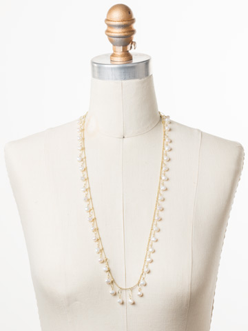 Milana Long Strand Necklace in Bright Gold-tone Polished Pearl displayed on a necklace bust