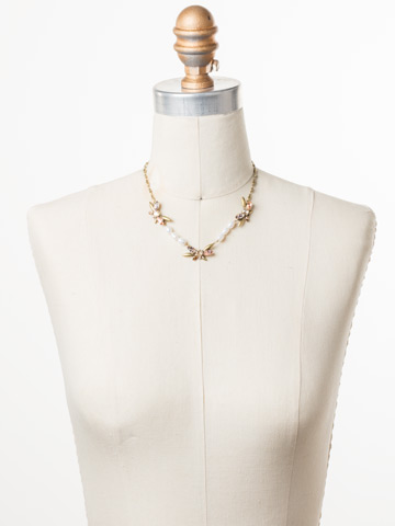 Elisa Necklace in Antique Gold-tone Beach Comber displayed on a necklace bust
