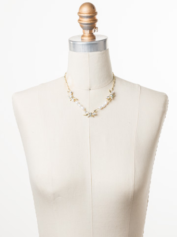 Elisa Necklace in Bright Gold-tone Polished Pearl displayed on a necklace bust