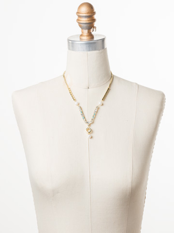 Aryana Necklace in Bright Gold-tone Polished Pearl displayed on a necklace bust