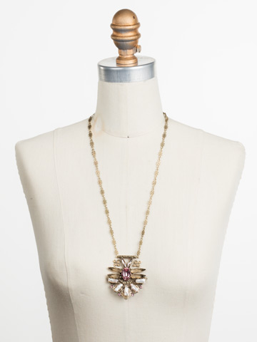 Amalia Necklace in Antique Gold-tone Beach Comber displayed on a necklace bust