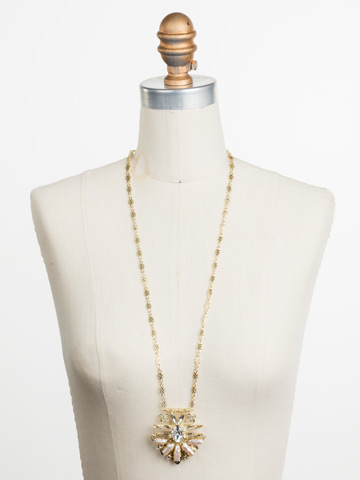 Amalia Necklace in Bright Gold-tone Crystal displayed on a necklace bust
