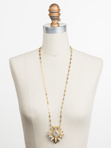 Amalia Necklace in Bright Gold-tone Polished Pearl displayed on a necklace bust