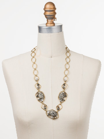Presley Long Strand Necklace in Antique Gold-tone Natural Elements displayed on a necklace bust