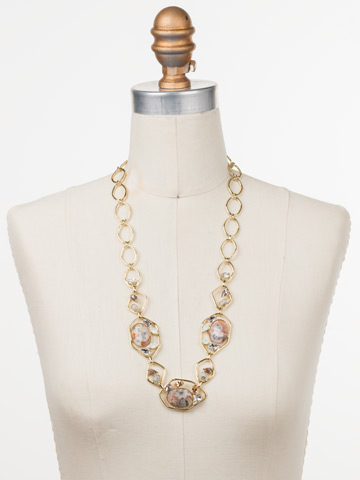 Presley Long Strand Necklace in Bright Gold-tone Silky Clouds displayed on a necklace bust