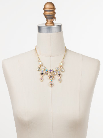 Ursula Statement Necklace in Bright Gold-tone Silky Clouds displayed on a necklace bust