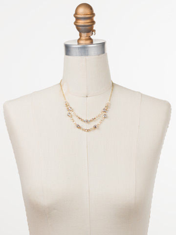 Sedge Mini Bib Necklace in Bright Gold-tone Silky Clouds displayed on a necklace bust