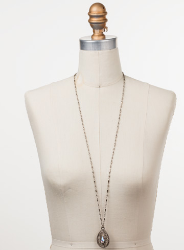 Fiona Long Strand Pendant in Antique Silver-tone Silky Clouds displayed on a necklace bust