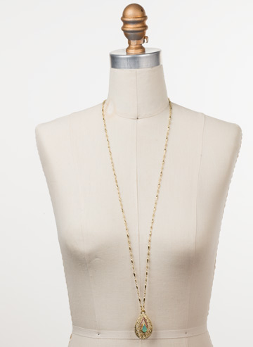 Fiona Long Strand Pendant in Bright Gold-tone Candy Pop displayed on a necklace bust
