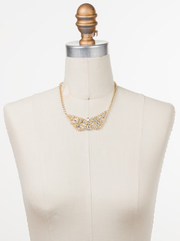 Karissa Statement Necklace in Bright Gold-tone Silky Clouds displayed on a necklace bust