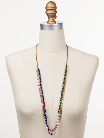 Brienne Long Strand Necklace in Antique Gold-tone Game of Jewel Tones displayed on a necklace bust