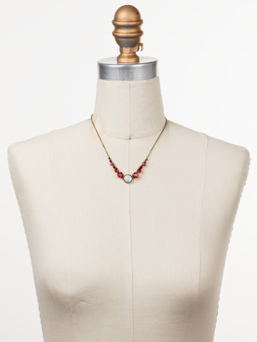 Meera Classic Necklace in Antique Gold-tone Sansa Red displayed on a necklace bust