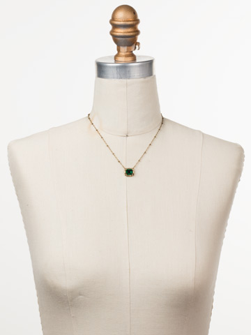 Meera Pendant Necklace in Antique Gold-tone Game of Jewel Tones displayed on a necklace bust