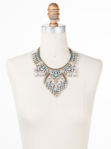 Tribal Statement Necklace in Antique Gold-tone Denim Blue displayed on a necklace bust