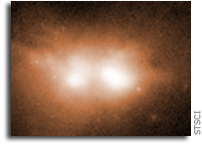 Astronomers Unveil Growing Black Holes in Colliding Galaxies