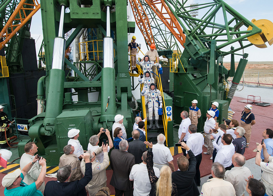 Russian capsule with three astronauts docks with space station