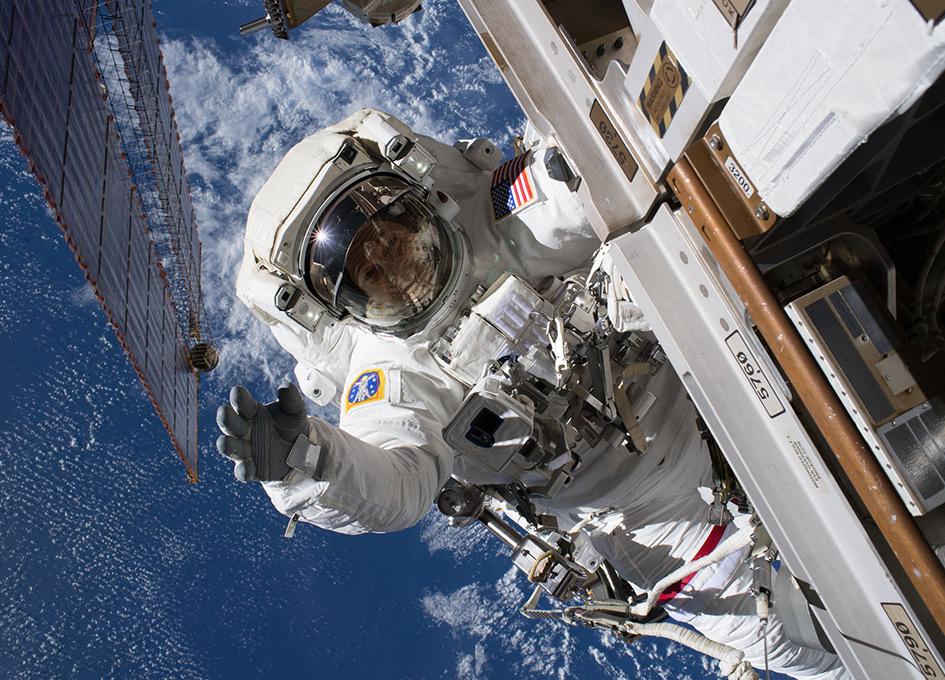 a 70 kg astronaut in space walking outside - photo #5