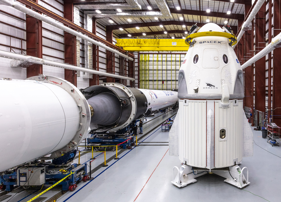 SpaceX Demo-1 Spacecraft and Falcon 9 Being Prepared For Launch