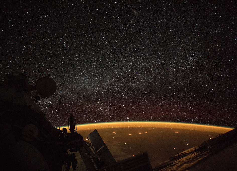 Orbital View: Earth's Atmospheric Glow And The Milky Way
