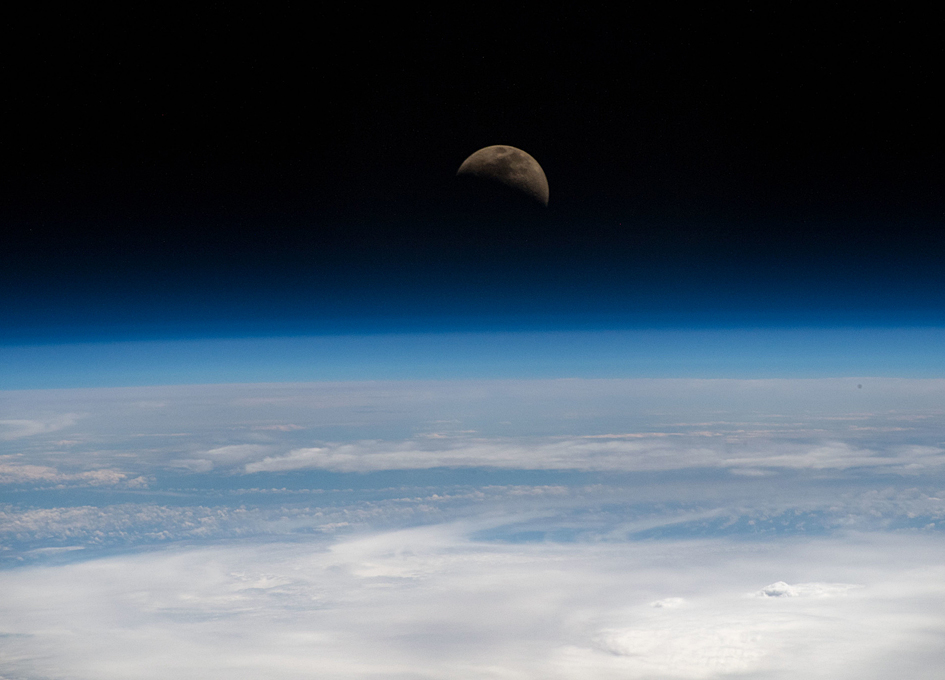 The Moon's First Quarter Phase As Seen From Earth Orbit