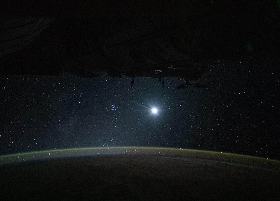 Orbital View: Earth's Glow, The Moon, The Stars