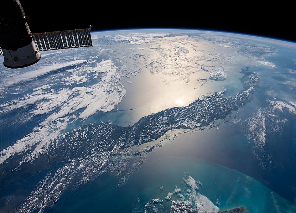 Orbital View Of Cuba And Caribbean Sun Glint
