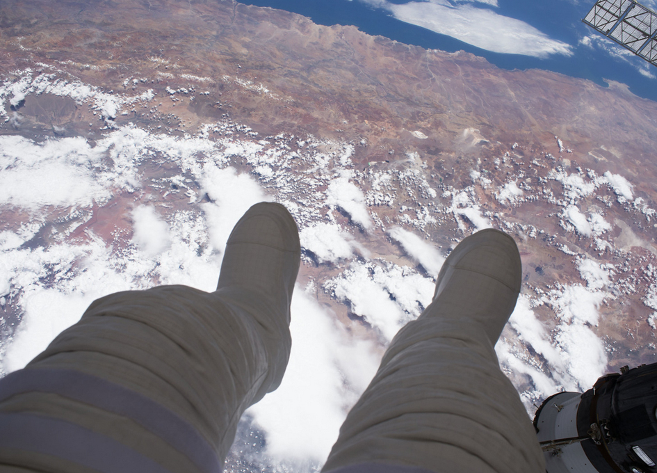 Boots Hanging Out Of An Orbital Base Camp