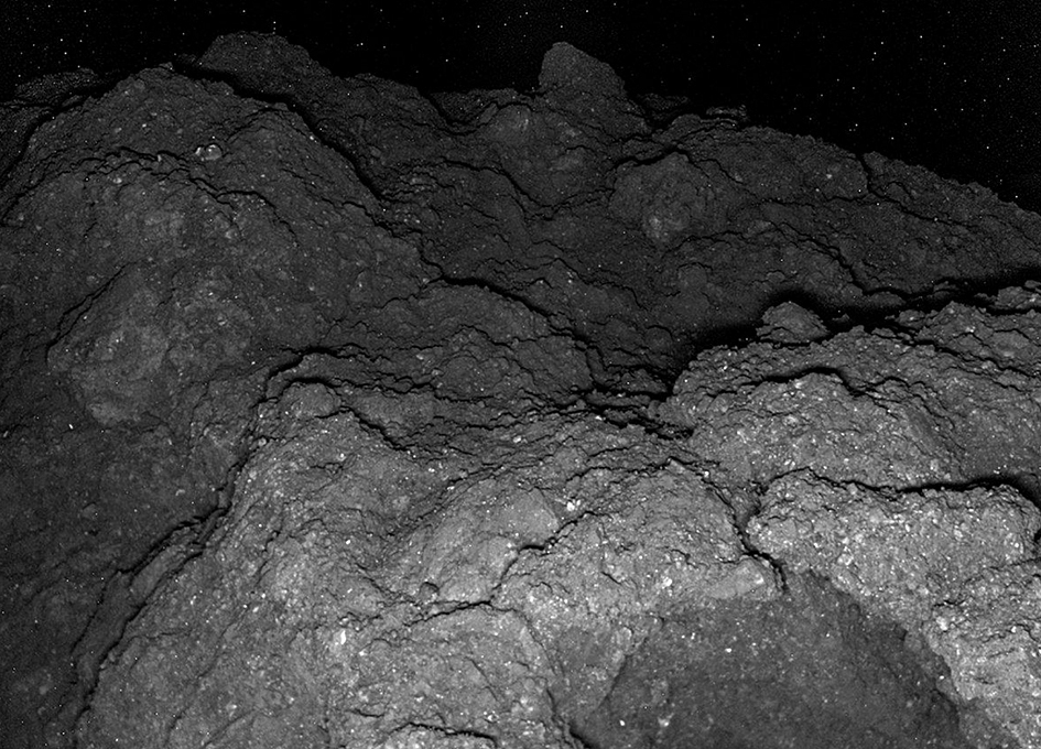 Images From The Surface Of Asteroid Ryugu Yield Clues To Its Composition