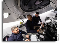 NASA Astronauts Work Aboard The Commercial SpaceX Crew Dragon Spacecraft