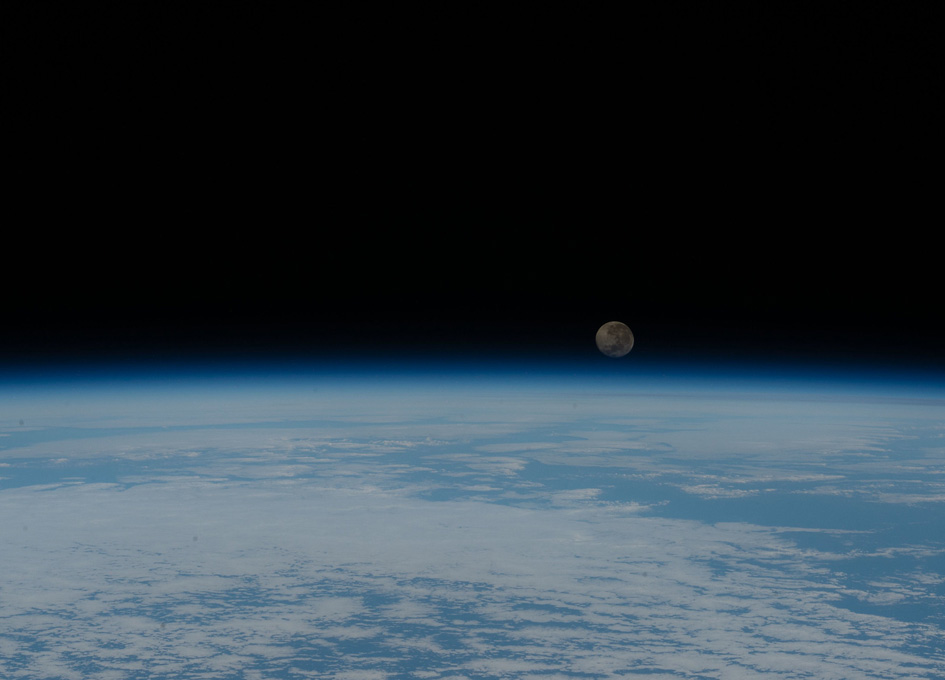 Waning Gibbous Moon Looms Above Earth's Horizon