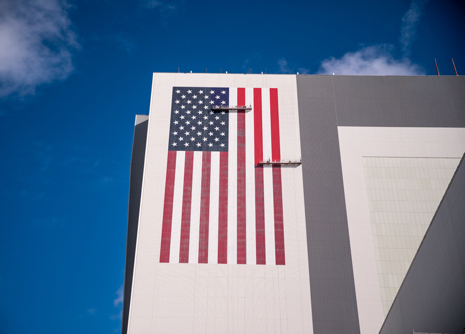 They're Re-Painting The Immense Flag On The VAB