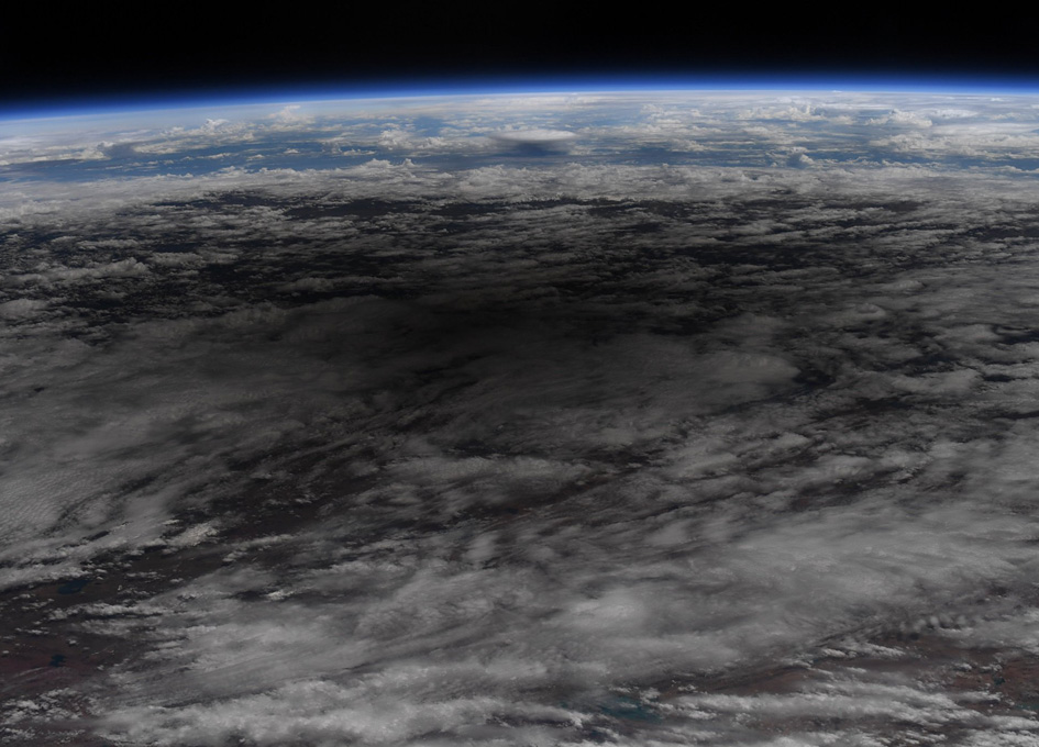 Annular Solar Eclipse Shadows Earth's Clouds As Seen From Orbit