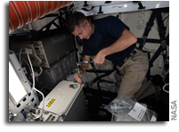 Loading A Science Freezer Inside A SpaceX Cargo Dragon
