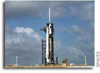 SpaceX Falcon 9 On The Pad With A Cargo Dragon
