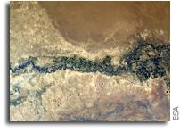 Orbital View Of Syr Darya River Flowing Through Kazakhstan, Uzbekistan, and Tajikistan