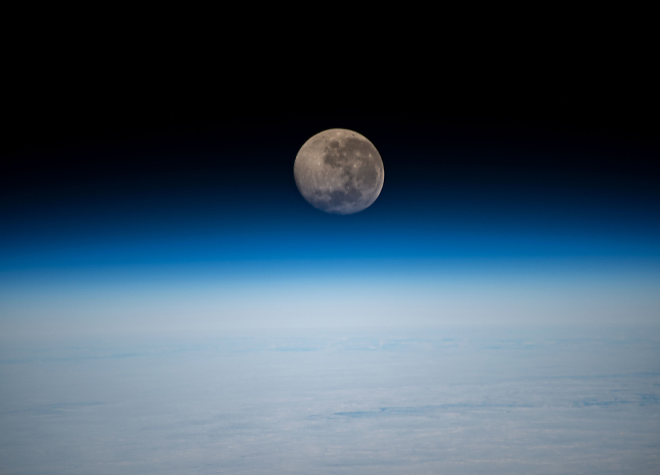 A Waning Gibbous Moon Above Earth's Horizon