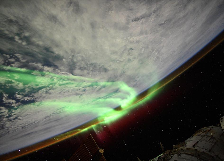 Orbital Aurora Below A Moonlit Sky