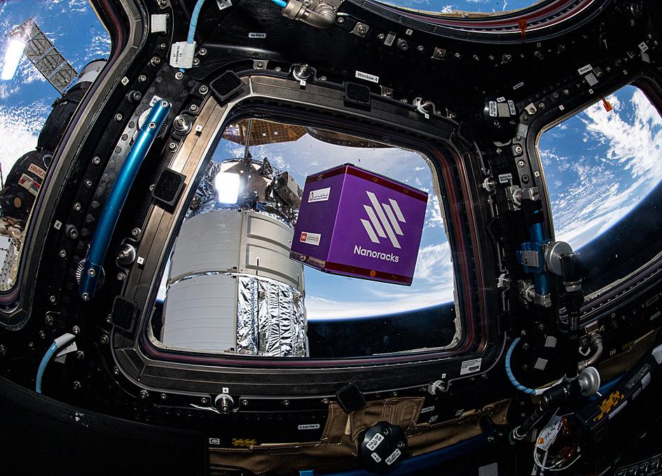 A Nanoracks Module Floats Inside The Space Station's Cupola
