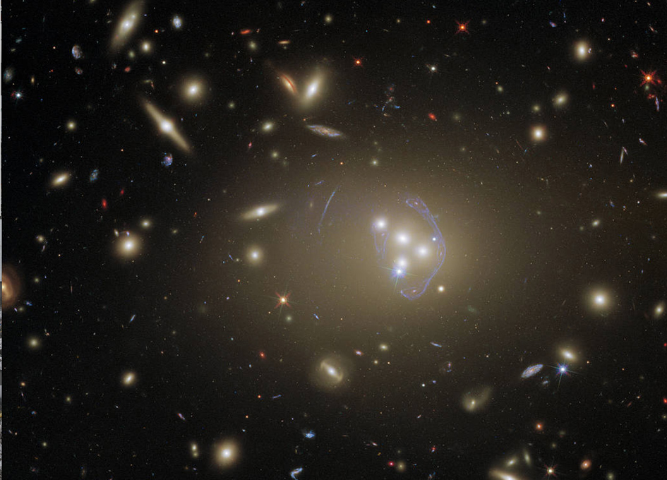Hubble Gazes At Abell 3827, A Cluster Full of Cosmic Clues