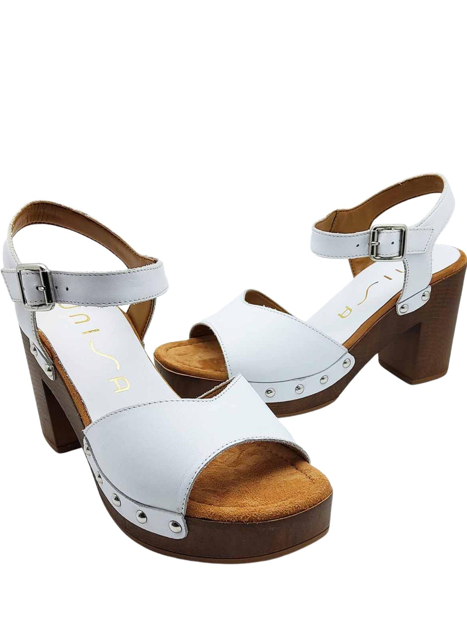 Calzature Donna Sandali Zoccolo in Pelle Bianca con Cinturino alla Caviglia e Tomaia Inchiodata Unisa | Sandali Zeppa | TACO100