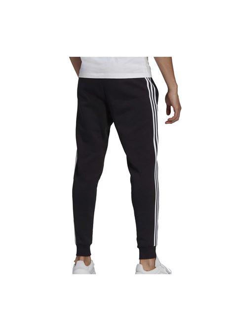 ESSENTIAL SLIM 3 STRIPES PANT ADIDAS CORE | Pantaloni | GM1089-