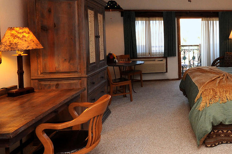 Table mountain inn guestroom desk balcony hpg