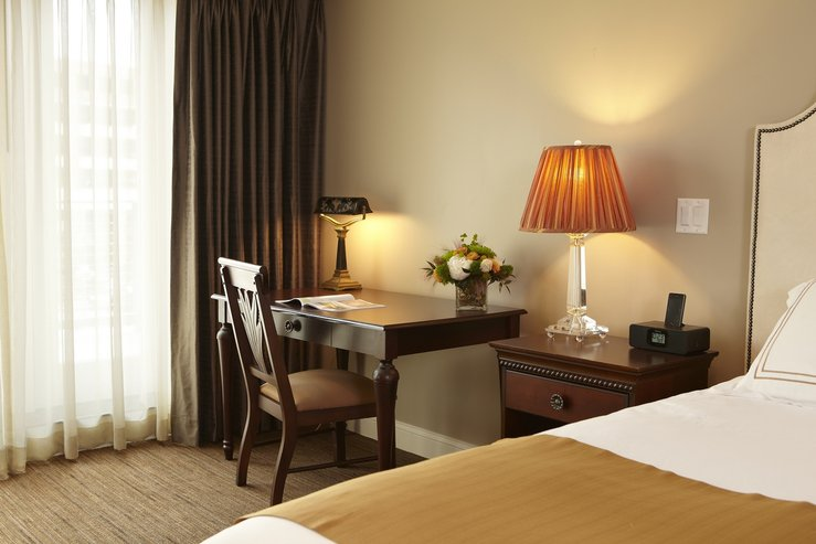 The portland regency hotel and spa studio suite bed and desk hpg