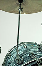Bass drum shell with cymbal holder and cymbal.